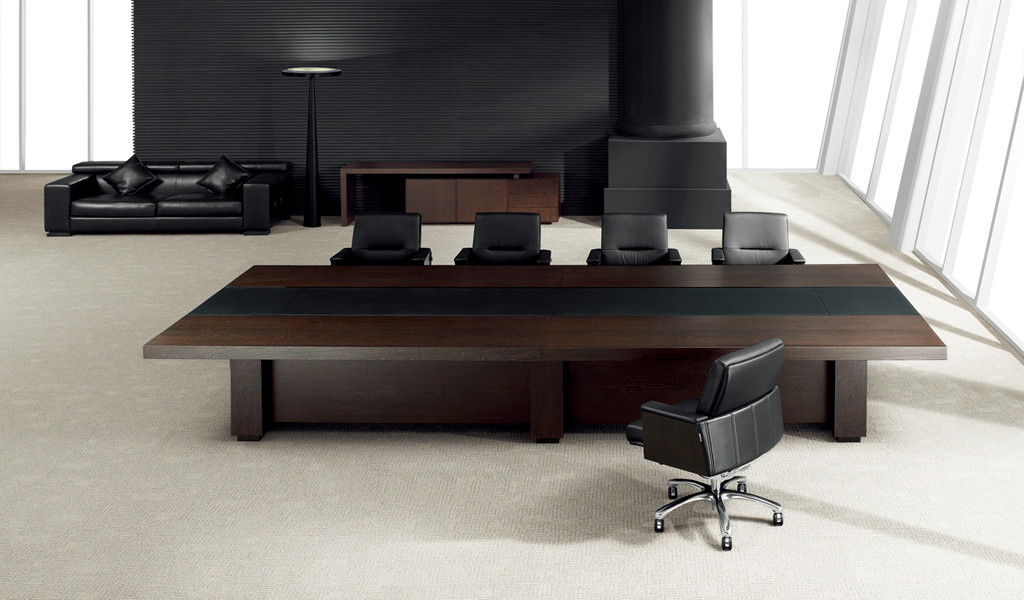 plush boardroom with dark wood and leather finish table and leather chairs