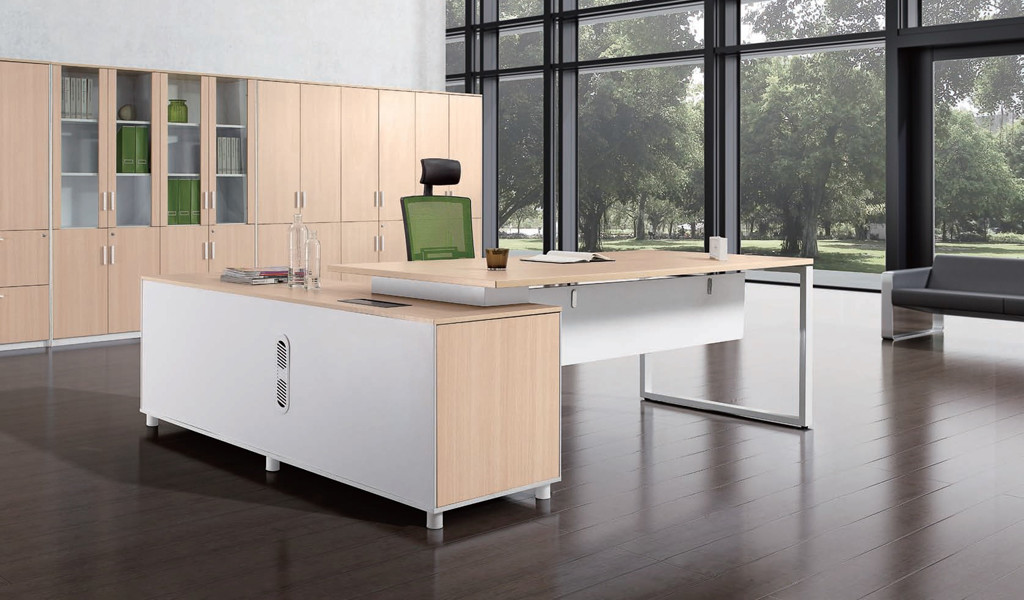 office cabin with light wood color L shape office desk and chair