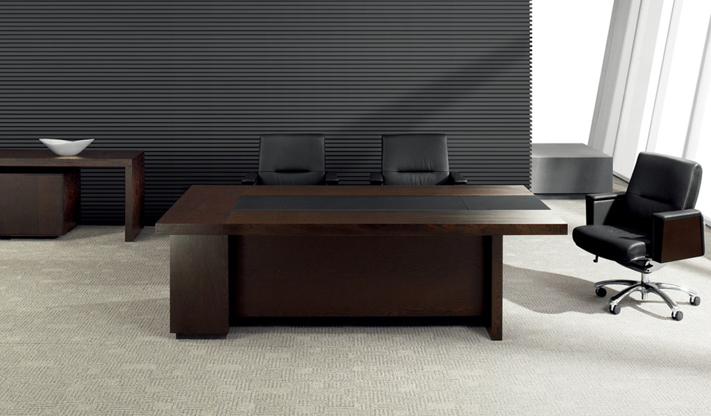 meeting room with dark wood table and leather chairs