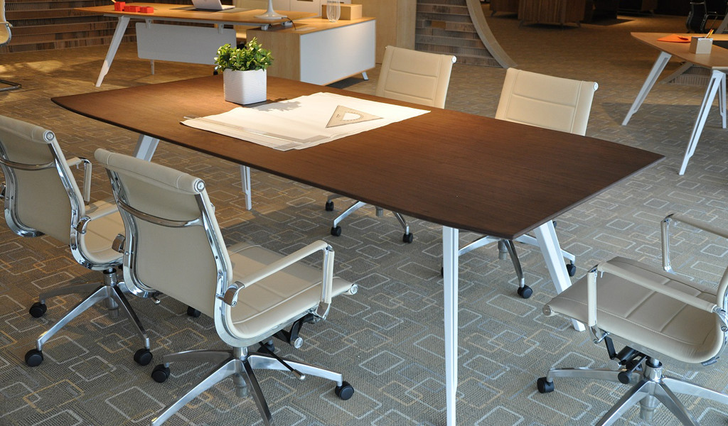 modern office with meeting table and sleek leather chairs