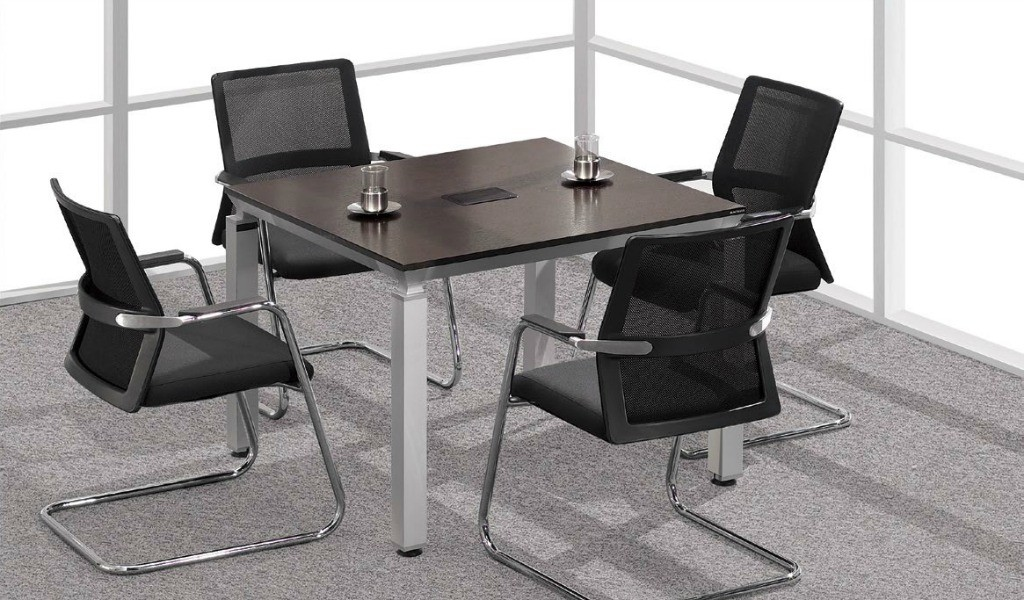 meeting room with small meeting table with four chairs