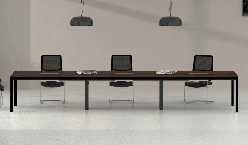 long meeting table with black chairs
