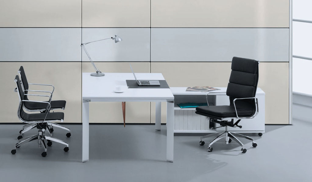 modern office desk in white color with side cabinet and black chairs
