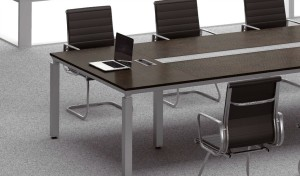 conference table in dark oak finish close up view