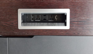 office tabletop with wirebox having power and data ports