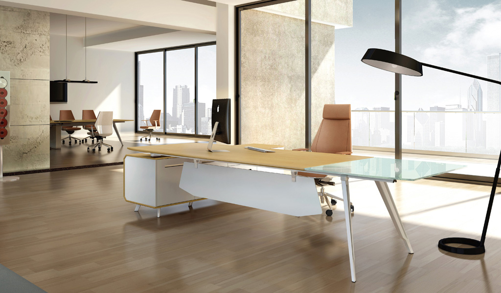 a large contemporary office cabin with a big office desk in light wood