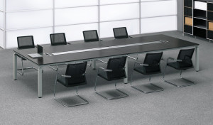 conference room with dark wood conference table and chairs