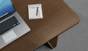 walnut veneer office table top with laptop and book