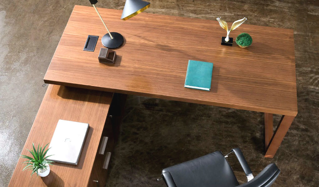 top view of L shape office desk in walnut veneer