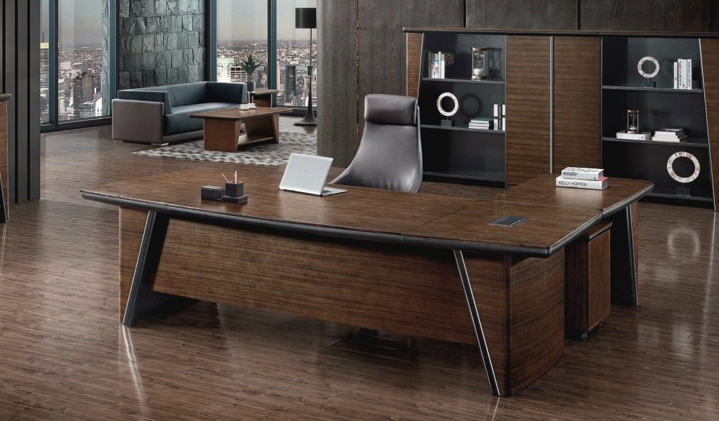 plush office cabin with walnut wood office table and leather chair