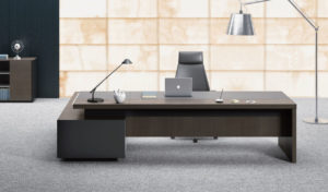 plush office cabin with large office table in walnut finish