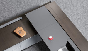 top view of L shape office table with leather covered top