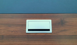 silver color wire box on meeting table top