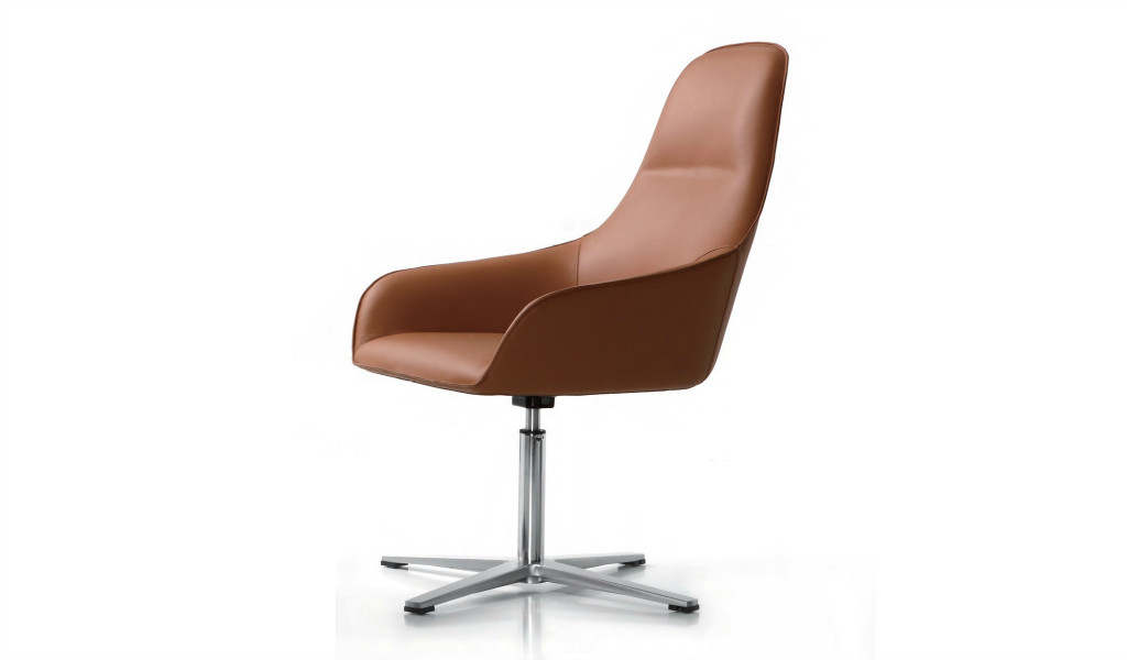 revolving lounge chair in tan leather with stainless steel base