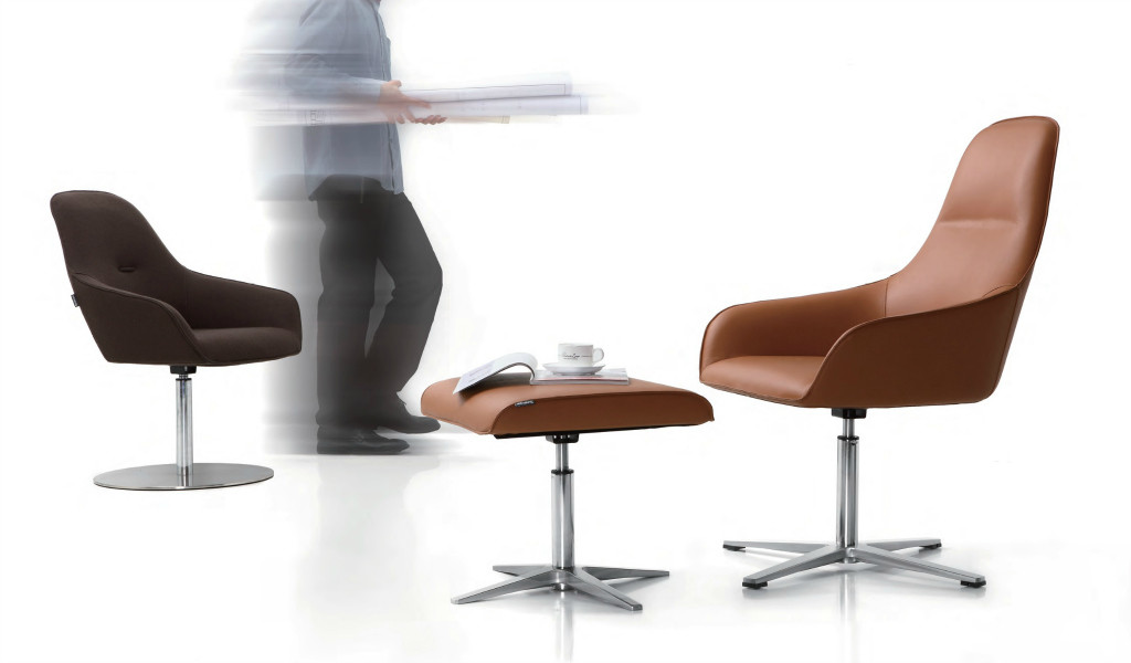tan leather lounge chair with foot stool