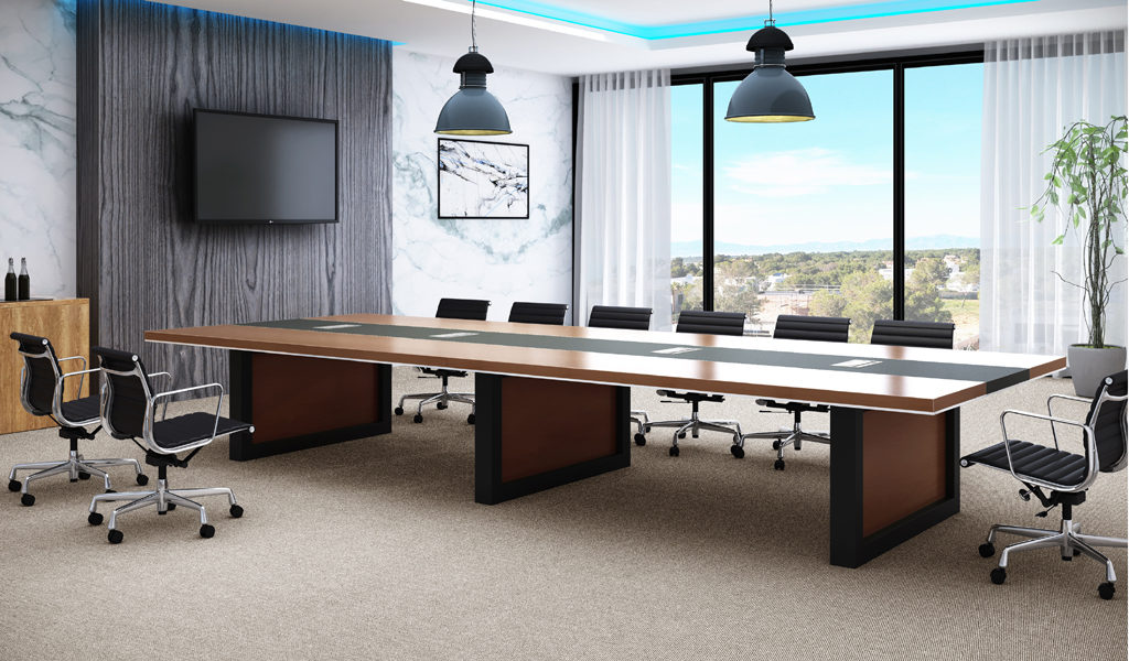 boardroom with walnut finish conference table and black leather chairs