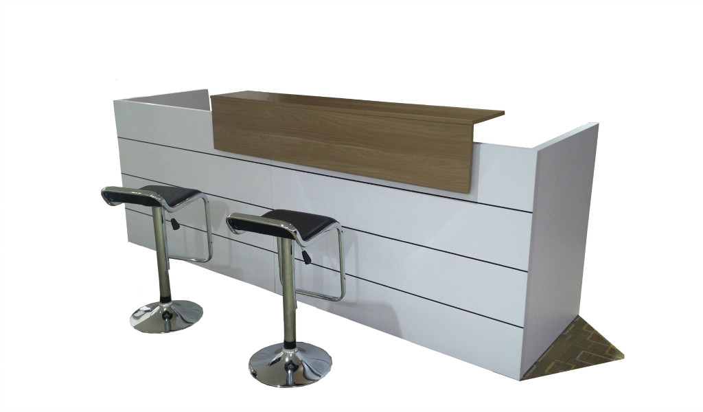 9 feet reception table in white laminate with walnut laminate counter top