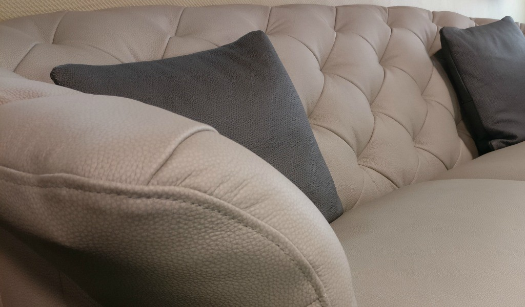 close up view of nubuck leather chesterfield sofa