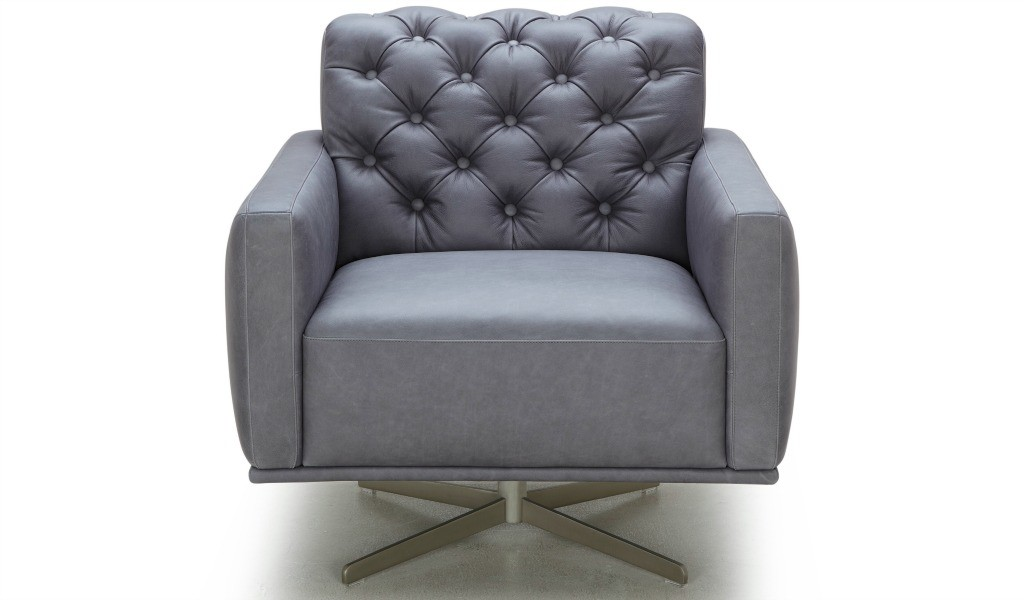 revolving lounge chair in leather with tufted back