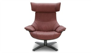 a reclining lounge chair in wine red leather