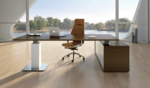 contemporary office with height adjustable premium office desk and tan leather chair