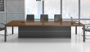 conference table with walnut veneer top and black chairs