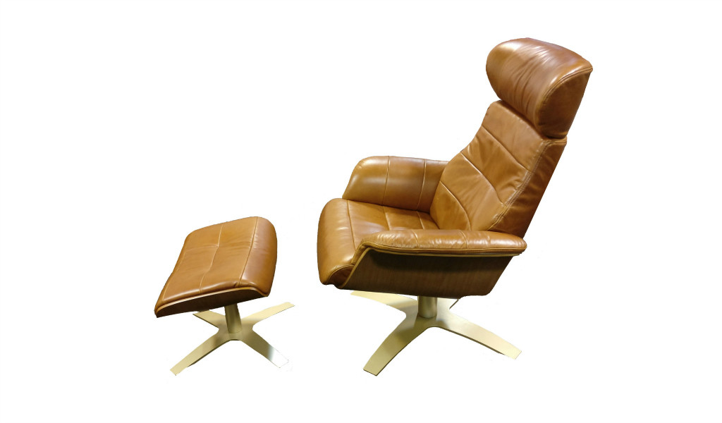 reclining lounge chair in tan leather with ottoman