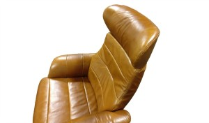 reclining chair headrest in tan leather