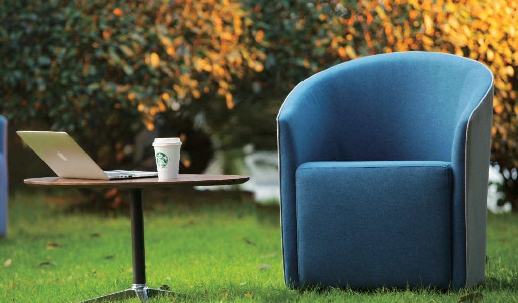 garden area with blue lounge chair in cashmere fabric and coffee table