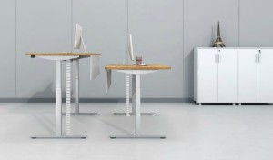 office with two motorized height adjustable desks