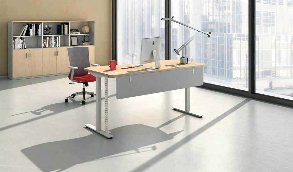 office cabin with height adjustable desk in light wood finish