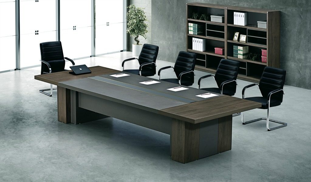 conference room with conference table in dark oak and black chairs