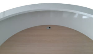round reception table with light oak worktop