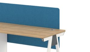 Single seater workstation in light wood and blue screen