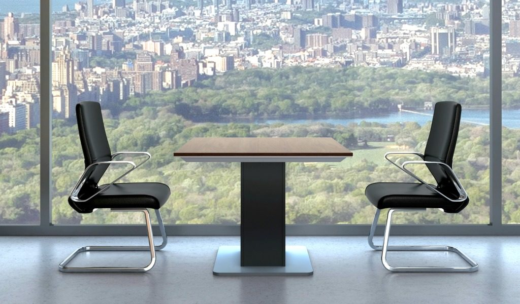 office cabin with square meeting table and two chairs