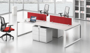 a four seater modular workstation system in white laminate with storage
