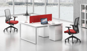 A two seater modular office desk system with two chairs