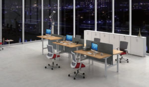 office with height adjustable workstation in a linear face to face setting.
