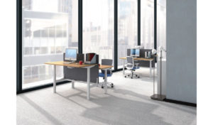 office with rows of height adjustable workstations