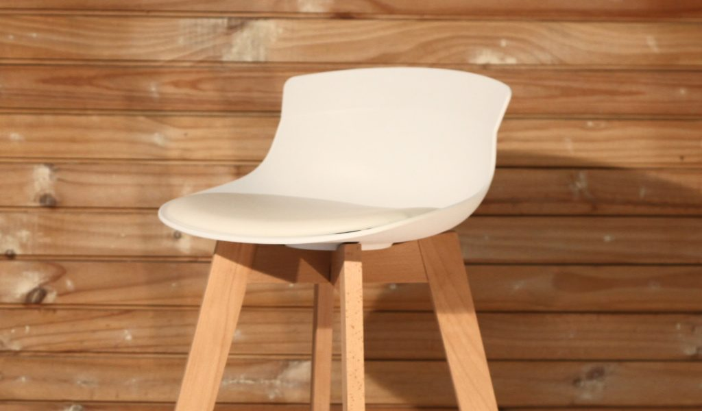 bar stool with white plastic seat and beech wood base