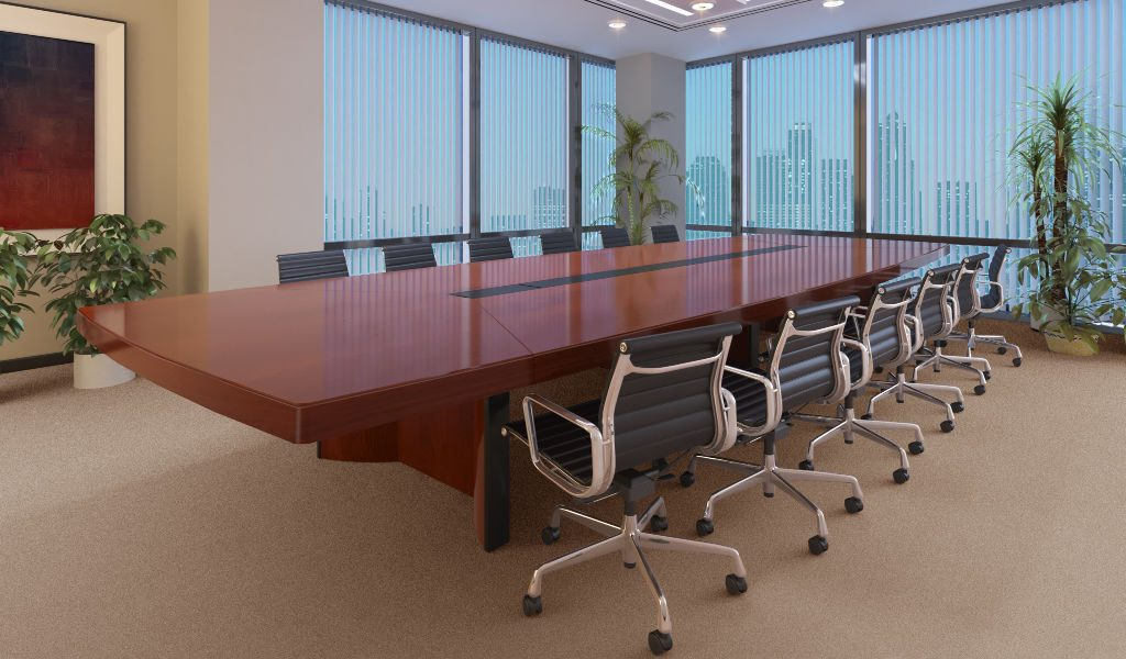 modern boardroom with wooden conference table and chairs