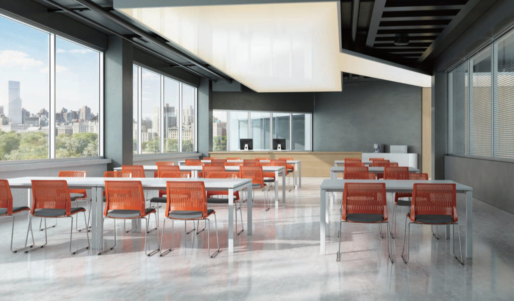 classroom with tables and orange color plastic chairs
